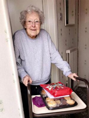 senior treats recipient at door